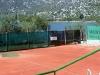 tennis courts near the lake..